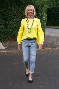 Yellow top with blue and white striped skinnies