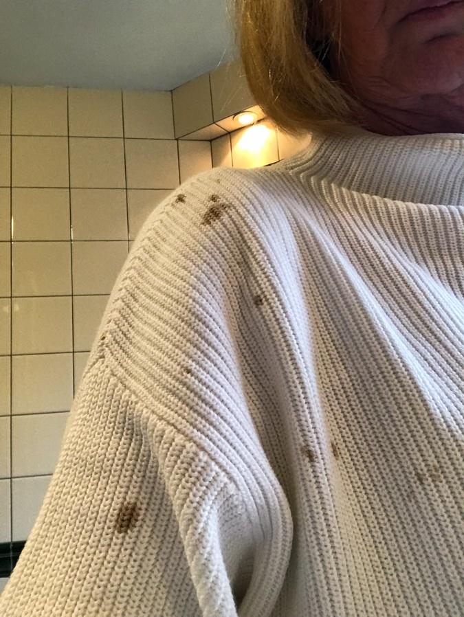ruined white sweater