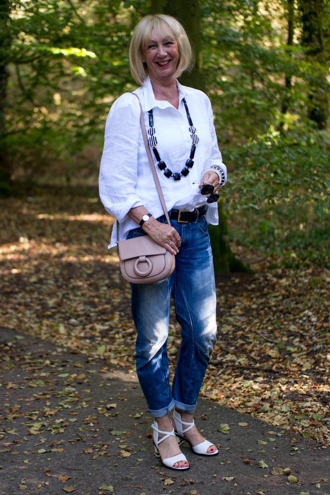 boyfriend jeans with white linen shirt and blush pink cross body bag