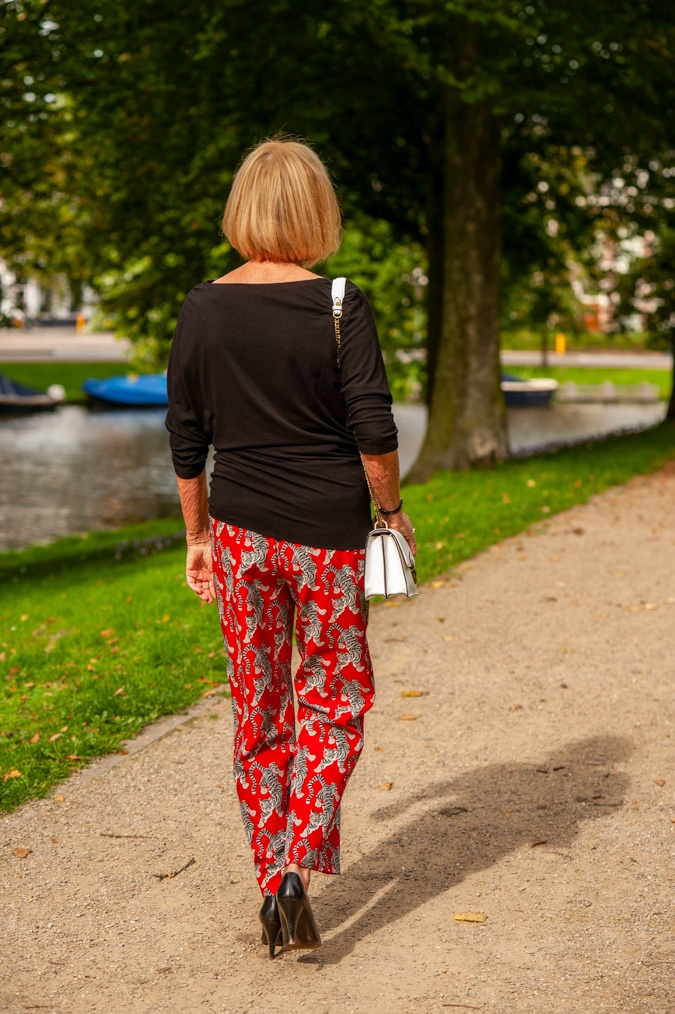 Red trousers with tigers and black top