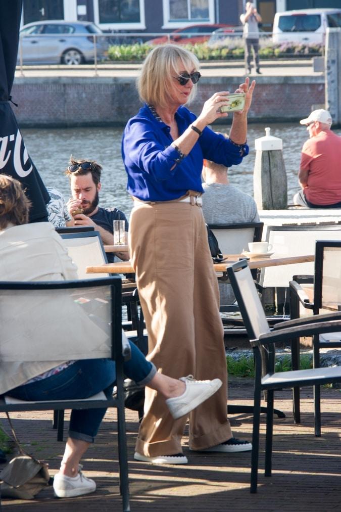 Khaki trousers and blue shirt