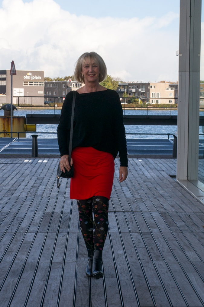 Floral tights and a red skirt