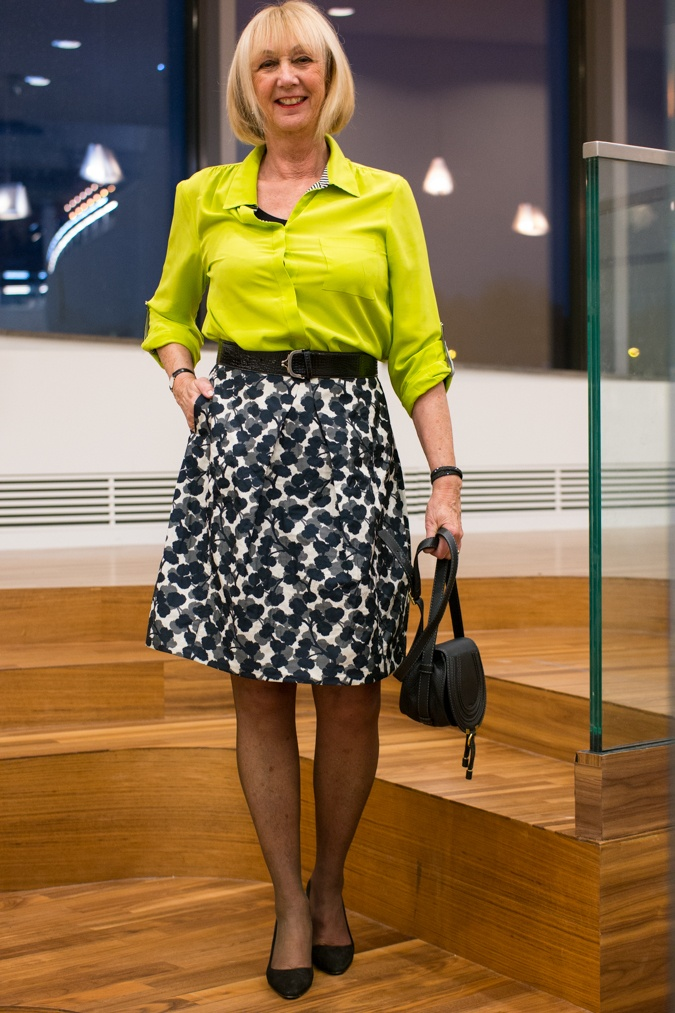 Lime shirt with black and white A-line skirt