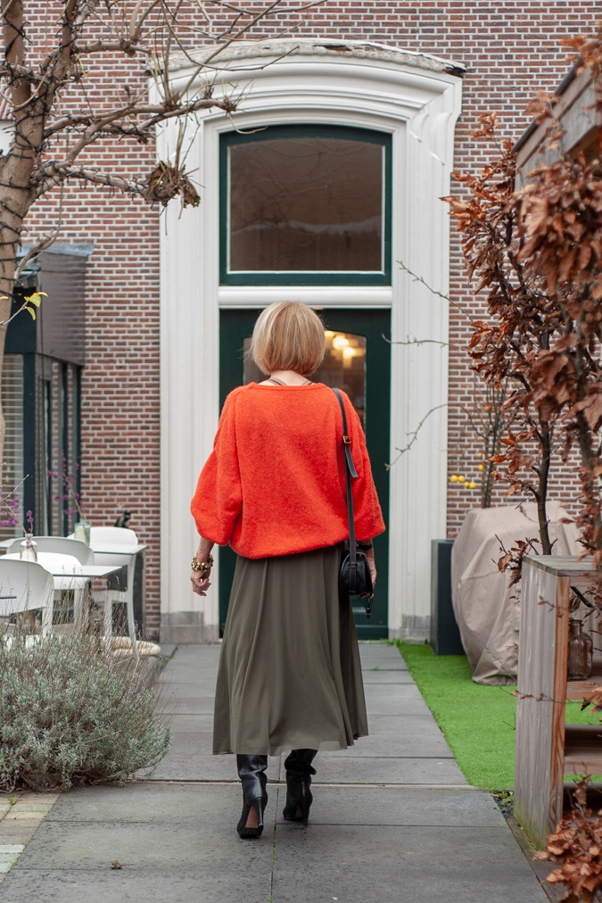 Long green skirt with orange jumper