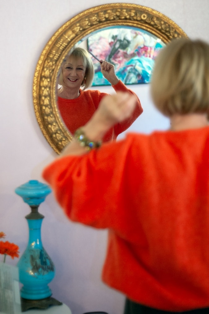 Orange jumper in mirror
