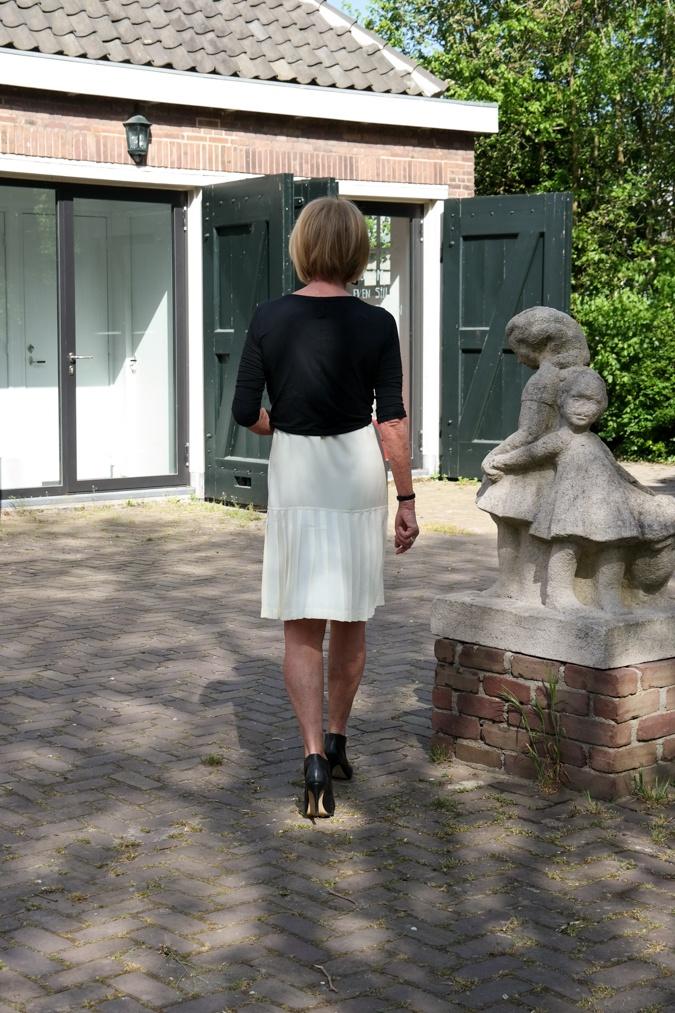 Yellow sleeveless dress with short black cardigan