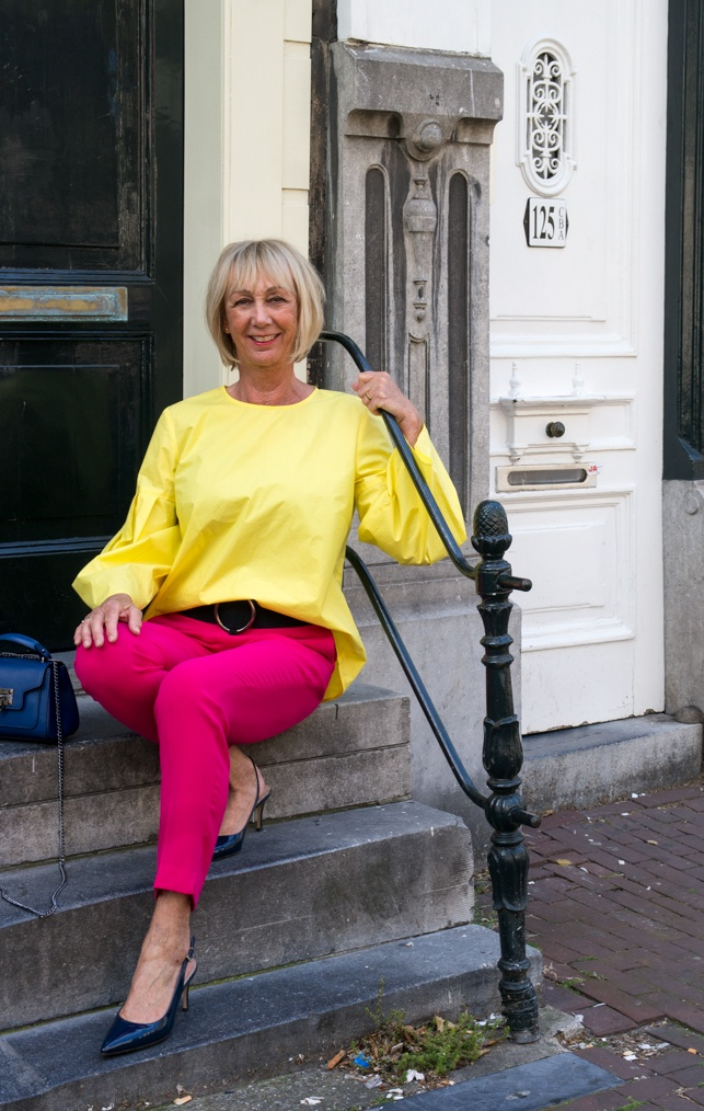Bright pink trousers with lemon yellow top