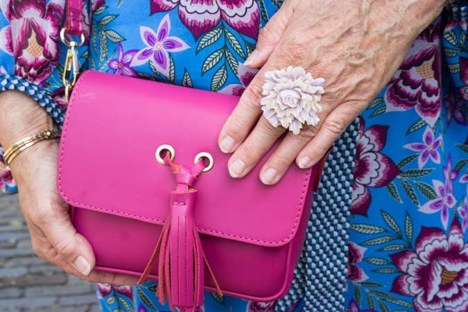 Fuchsia bag and lavender ring