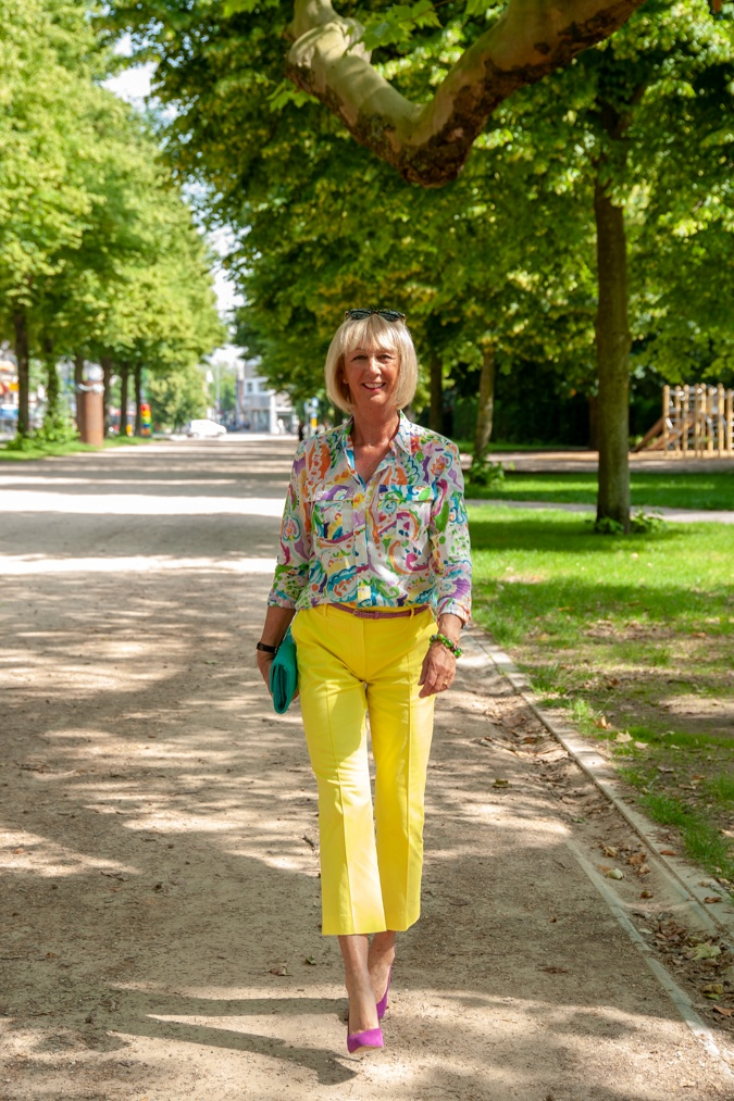 Lemon yellow trousers and multi-coloured shirt
