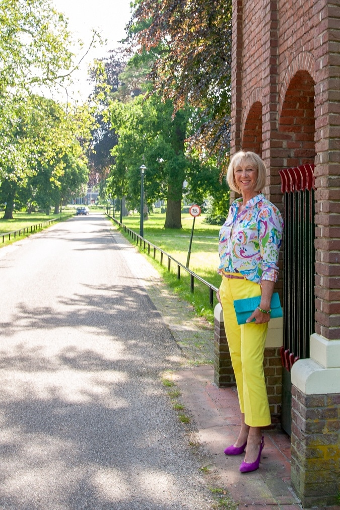 Lemon yellow trousers and a multi-coloured shirt
