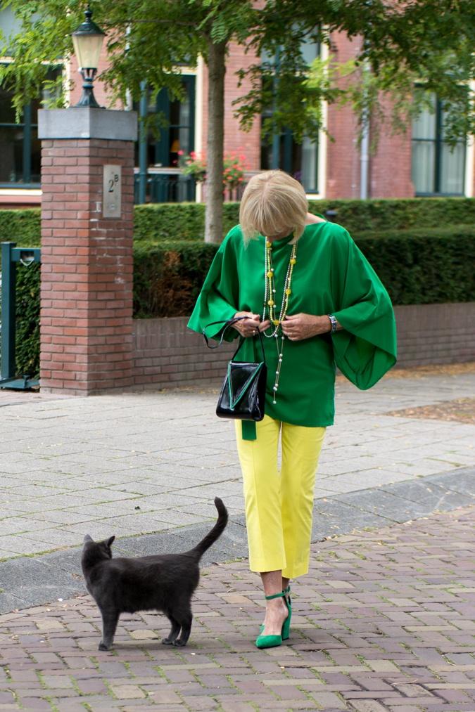 Lemon yellow trousers with a green kimono top