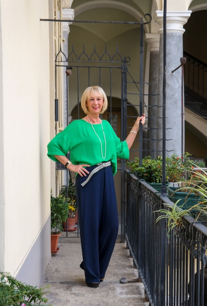 Green top and wide blue trousers
