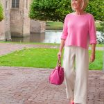 Pretty in pink: cream trousers and pink jumper