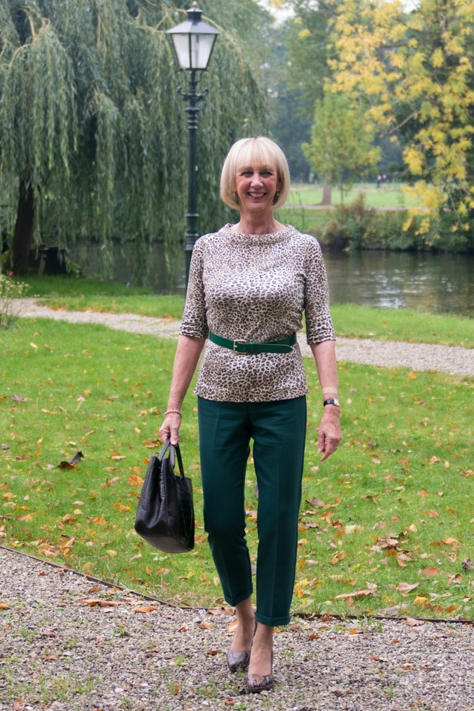 Green trousers with a leopard top
