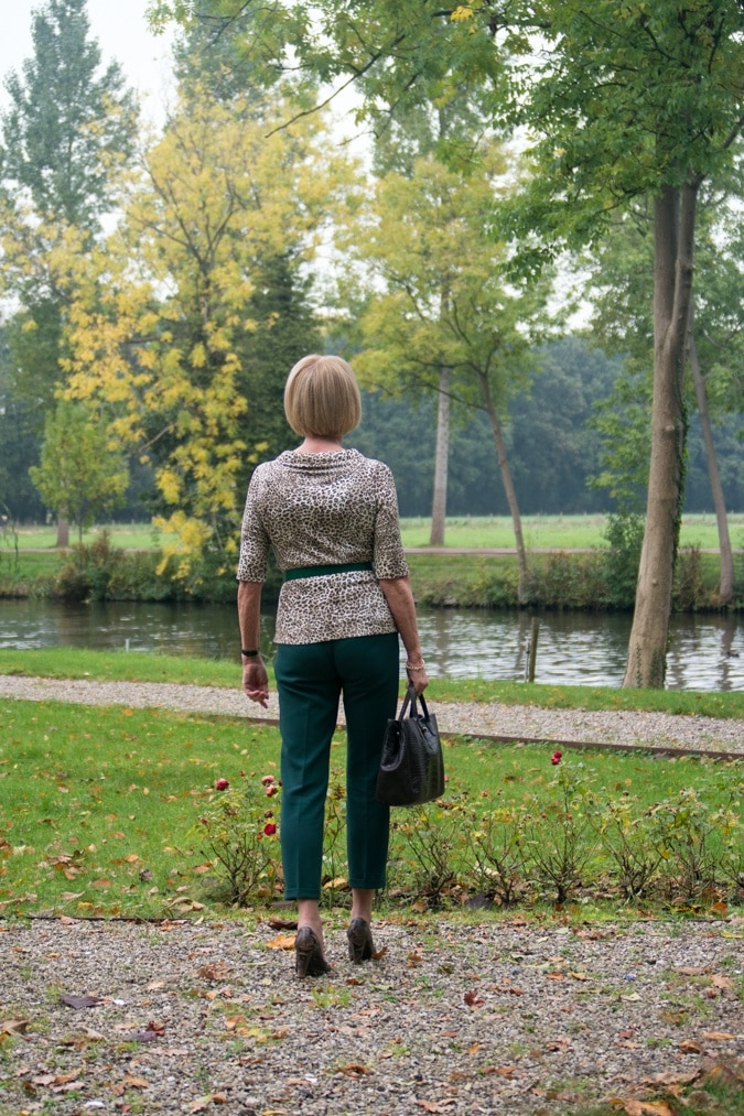 Green trousers with leopard top