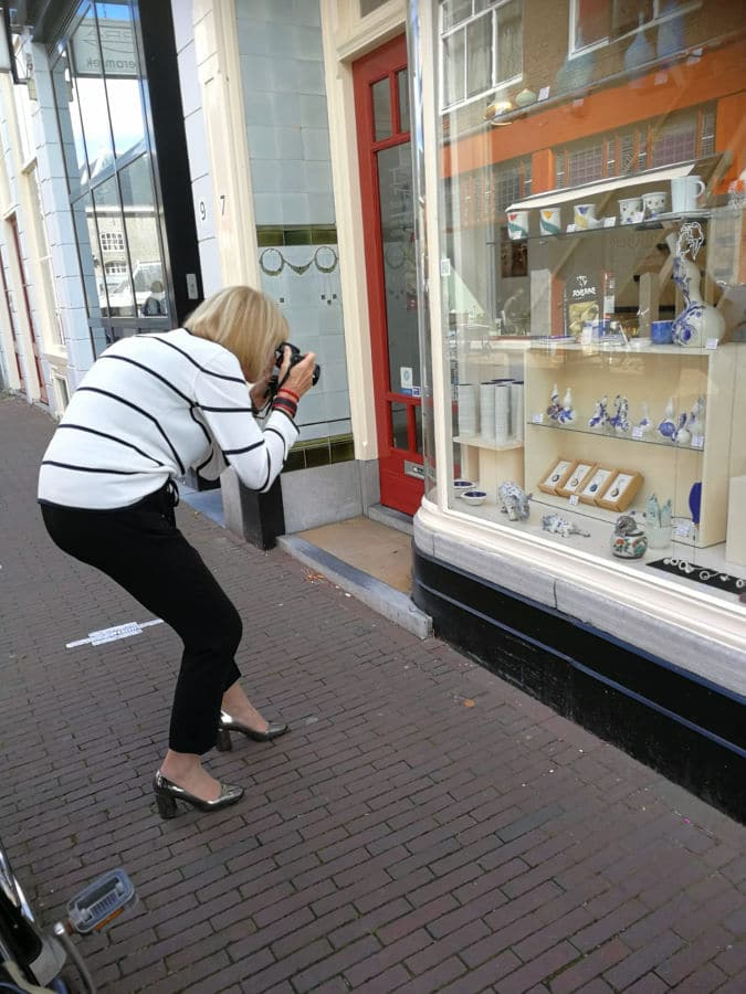 Taking photographs in Delft in a black and white striped jumper