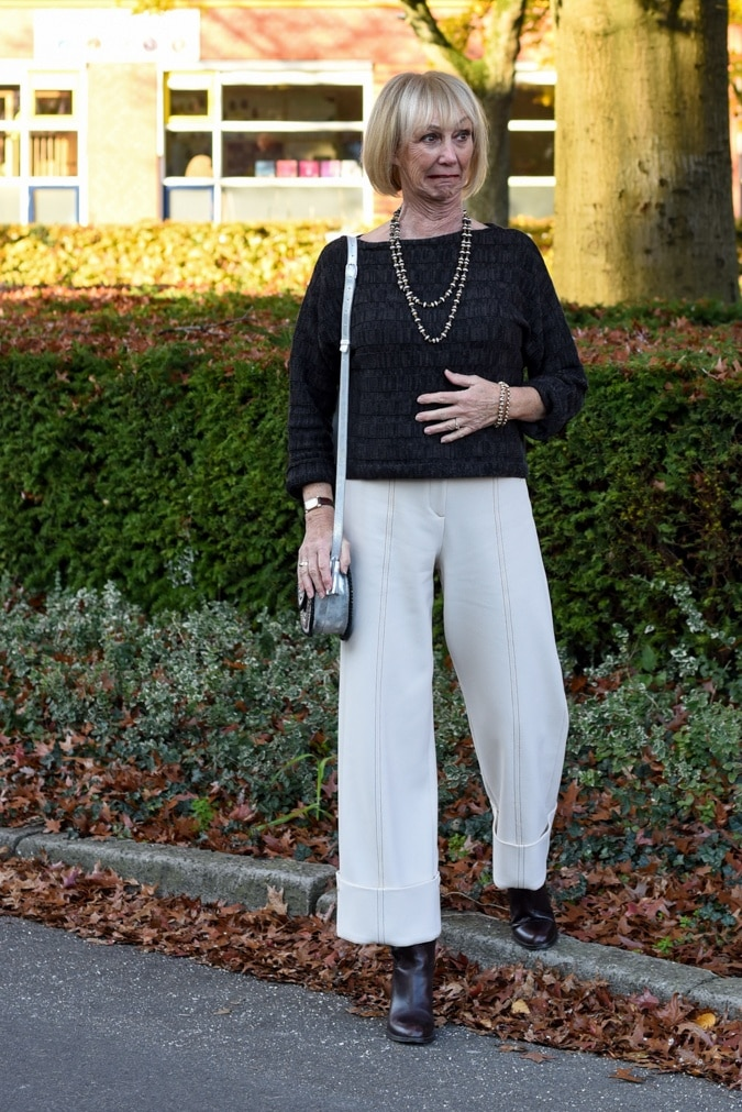 Cream trousers with brown jumper