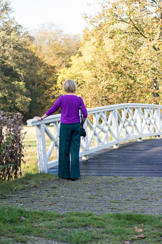 Wide green trousers with purple jumper