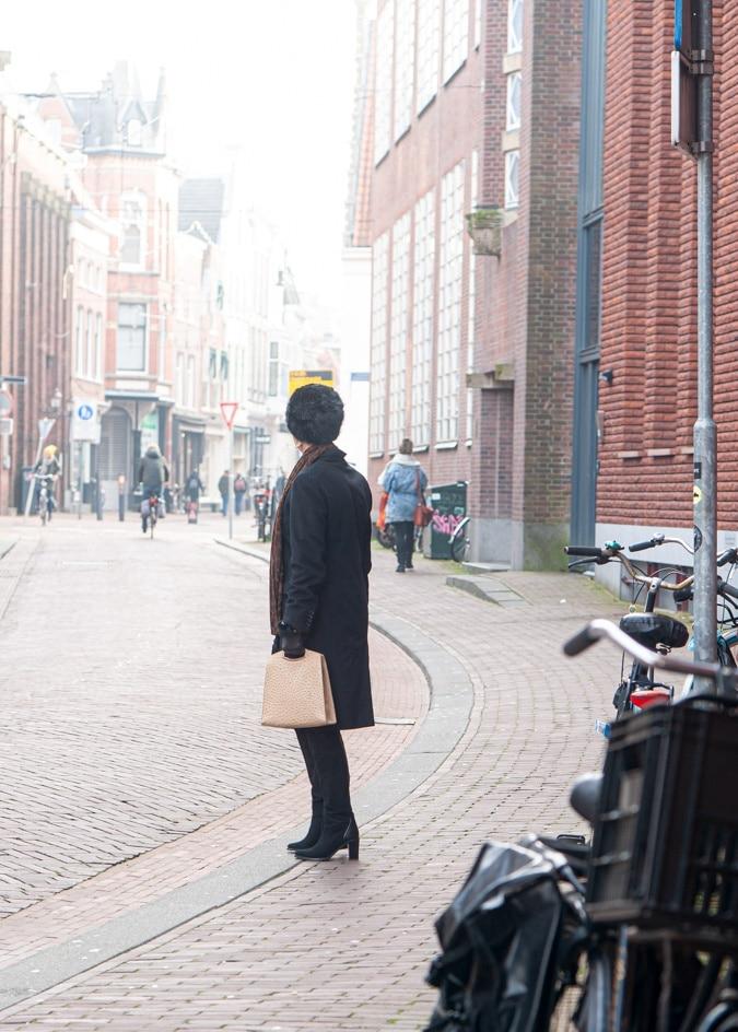 Black Max Mara coat and faux fur hat