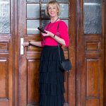 Tiered ruffle skirt with a bright pink jumper