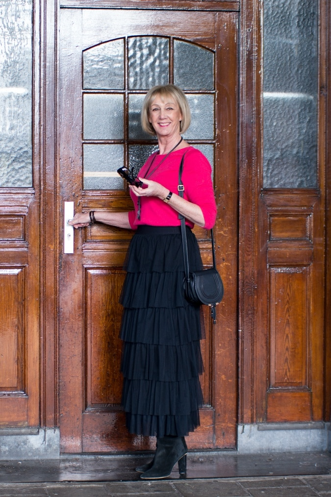 Black tiered ruffle skirt with bright pink jumper
