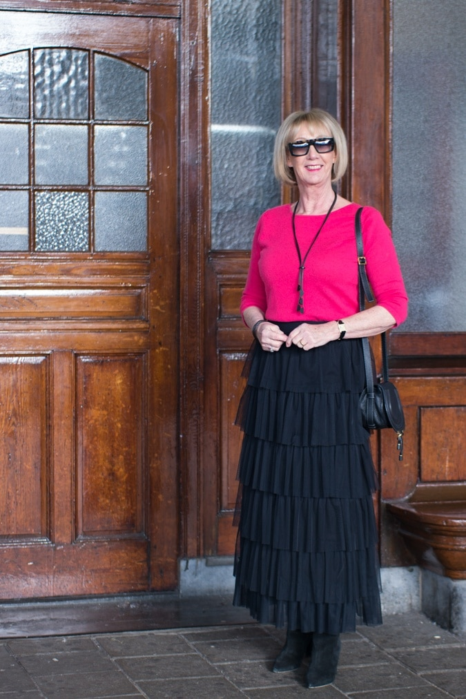 Tiered ruffle skirt with bright pink jumper