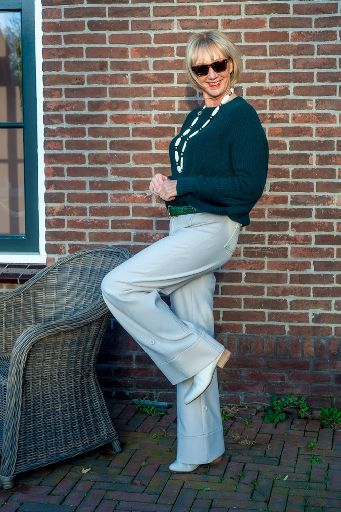 Dark green jumper with cream trousers