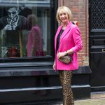 Bright pink jacket and leopard trousers