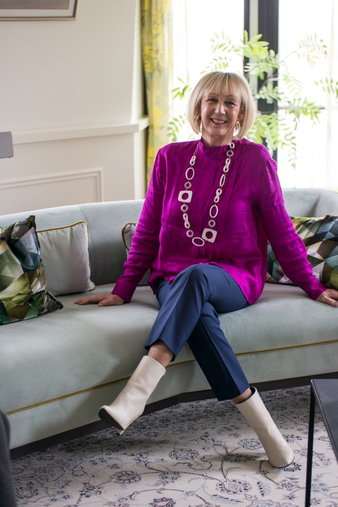 Bright purple blouse on 7/8 blue trousers