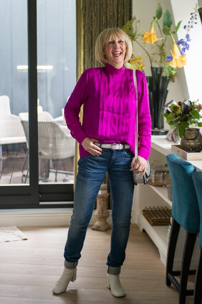 Bright purple blouse on jeans