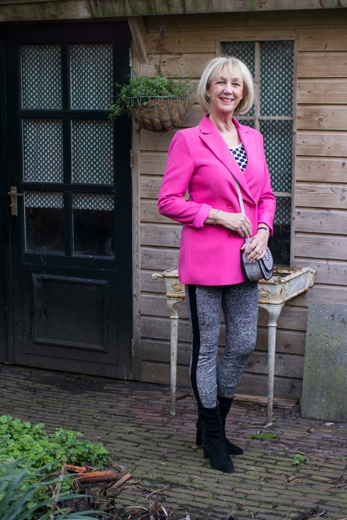 Bright pink jacket with houndstooth leggings and retirement