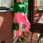 Pink trousers with a green jumper