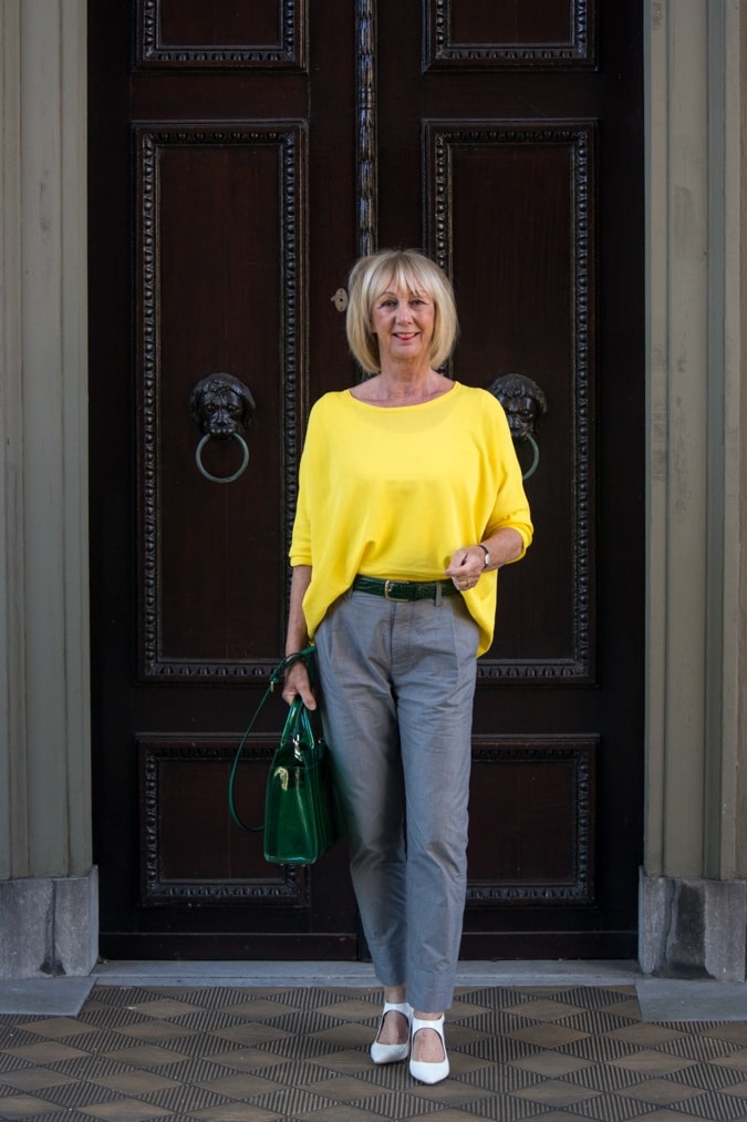Grey trousers with a yellow jumper