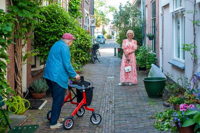 Pink and orange maxi dress and Leny van Schaik