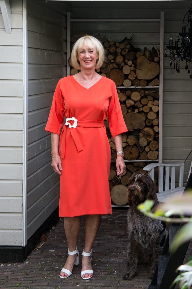 Orange dress and white block heeled sandals