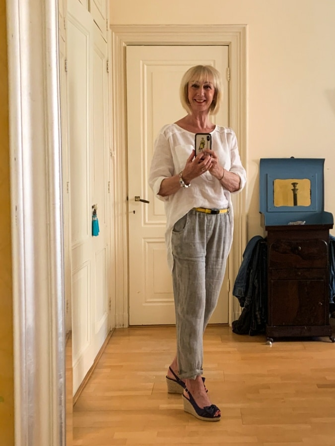 Grey linen trousers and white shirt