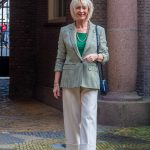 A houndstooth blazer in green and cream