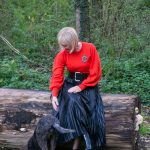Red jumper on black pleated skirt