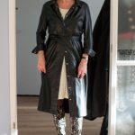 A black shirt dress with python print boots