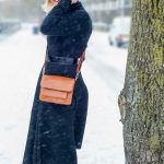 A flared black midi skirt in the snow