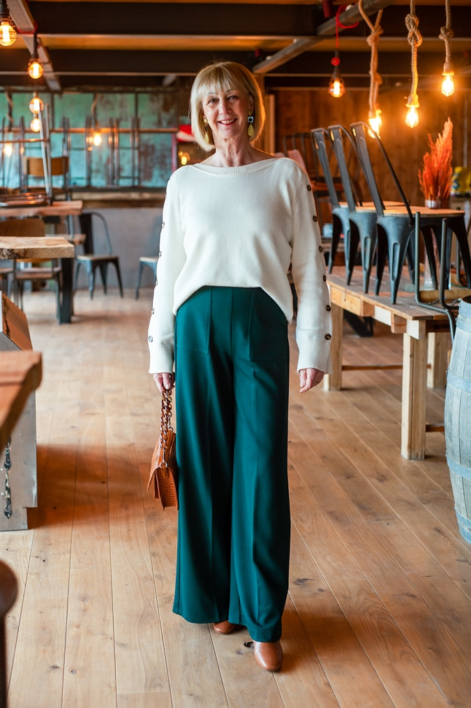 Cream jumper on wide green trousers