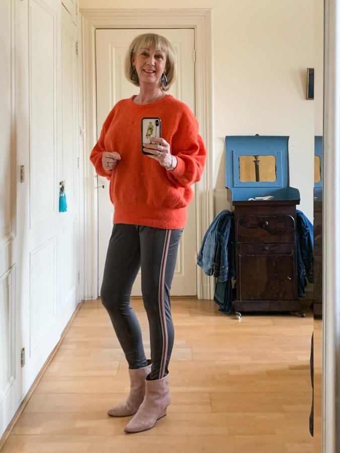 Orange jumper on olive leggings with side stripe