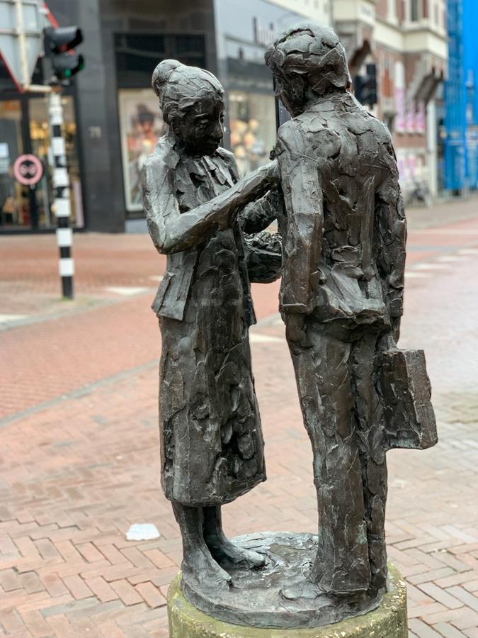 Statue flower girl by Kees Verkade