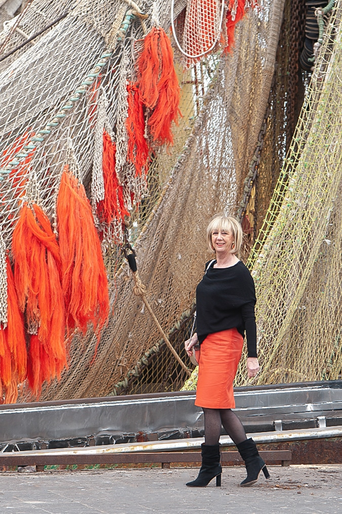 An orange leather skirt at the docks