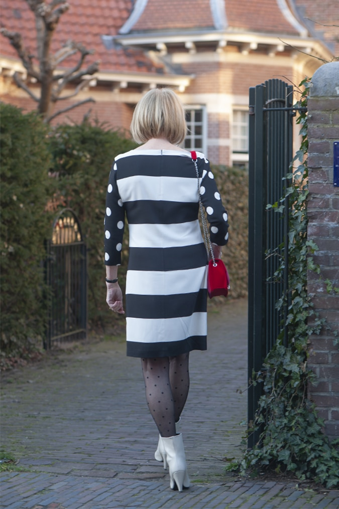 black and white dress with stripes and polka dots