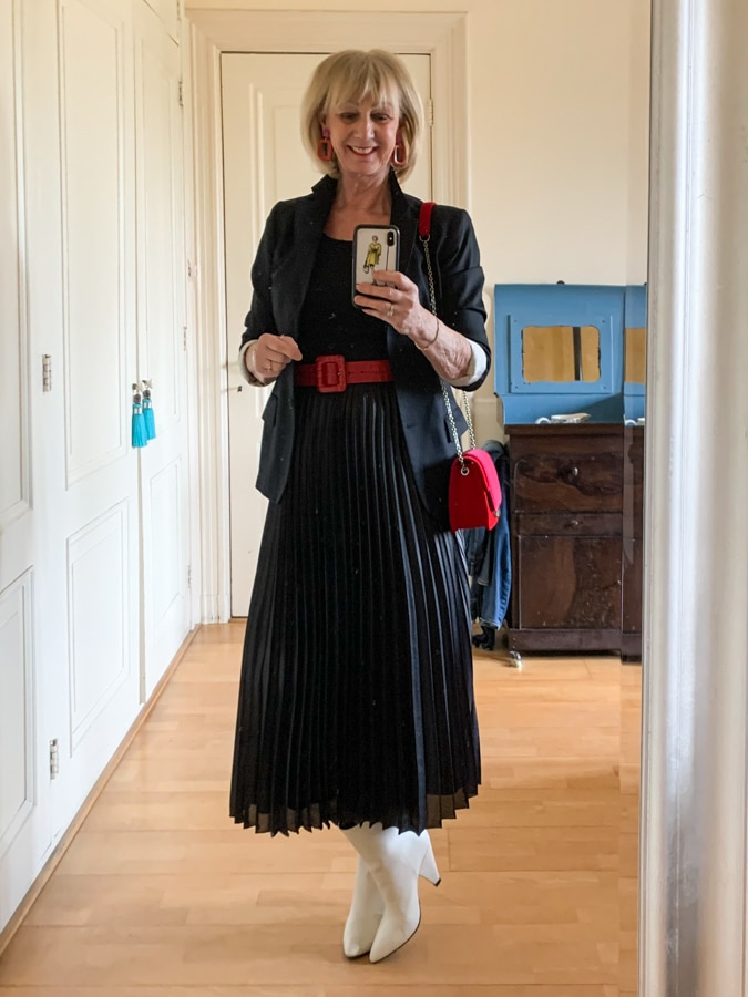Black pleated skirt with red and pink accessories