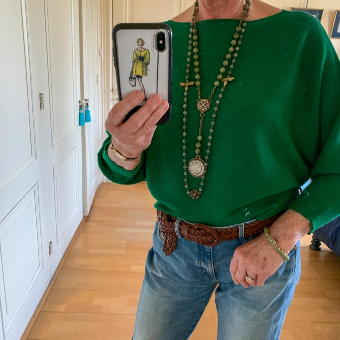 Green jumper with French Kande necklaces and bracelet