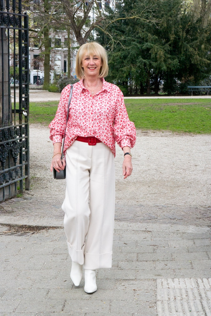 Red and cream shirt on cream trousers