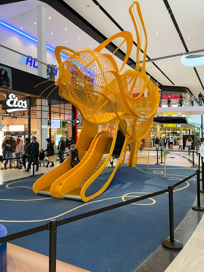 Cat as playground for kids in the mall