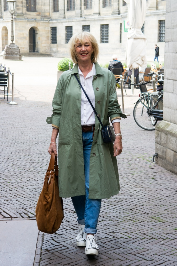 Walking through Amsterdam in a wide green trench coat